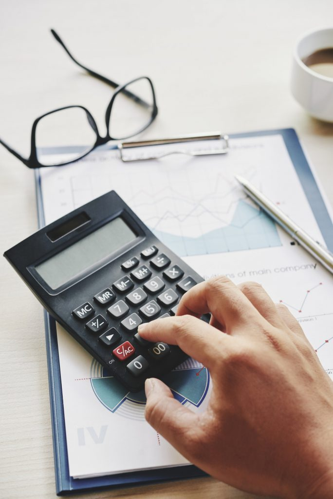Manager calculating expenses